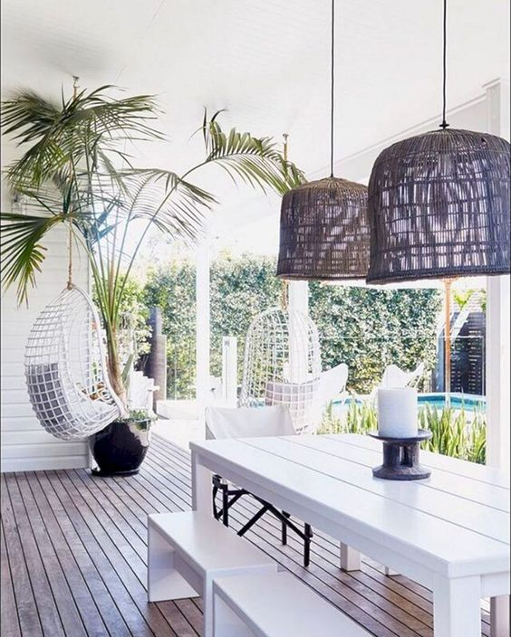 patio, wooden floor, white wooden wall, white wooden bench and table, rattan pendant, white rattan swing