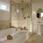 Pedestal Bathroom Vanity Beige Floor And Wall Tiles Built In Tub Glass Shower Door White Drawers Wall Mirror Towel Holder Window Wall Sconces