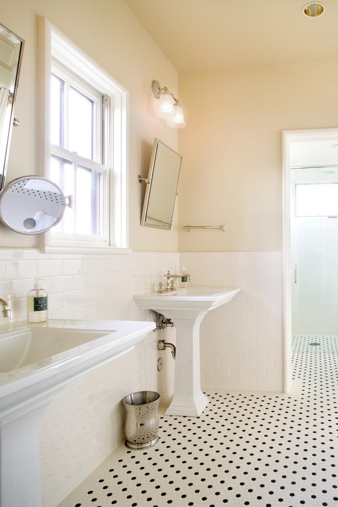 pedestal bathroom vanity beige wall white subway tile black and white mosaic floor steel trash bin make up mirror mounted wall mirror window wall sconces