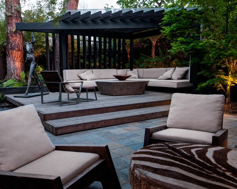 pergola on existing deck raised wooden deck wooden chairs wooden table concrete floor tile beige cushions beige pillows stool