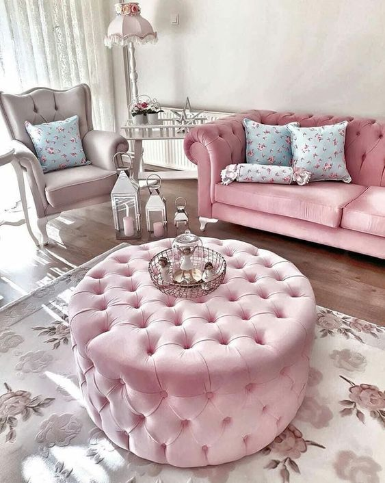 pink glossy sofa with tufted back and arm rest, pink tufted round ottoman, beige chair with tufted back