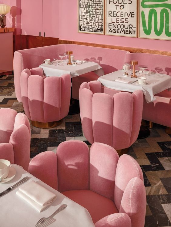 pink modern shell chairs on diner with pink long sofa, white square table