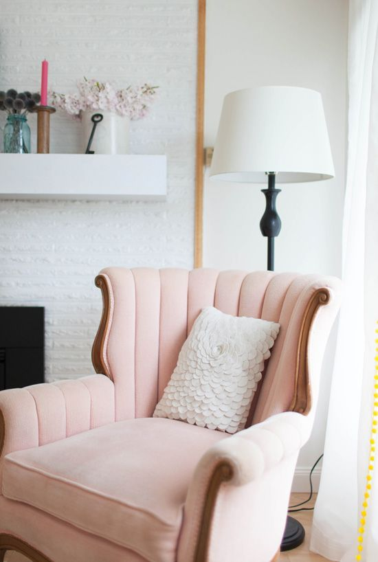 pink velvet shell chair with wooden frame, white floor lamp, white open brick wall, wooden floor