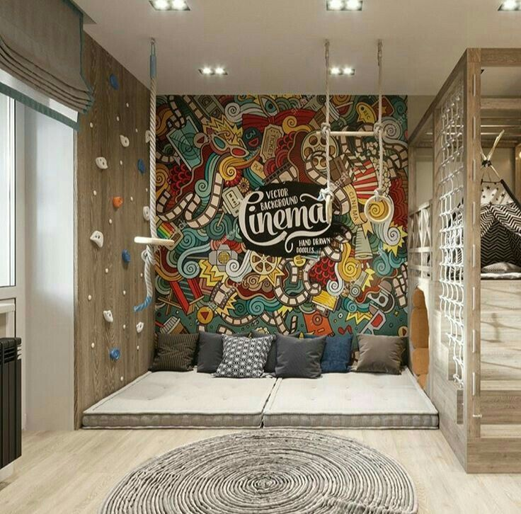 playroom, wooden floor, round rug, matresses, pilows, colorful wallpaper, climbing wall, swing, tent, climbing rope