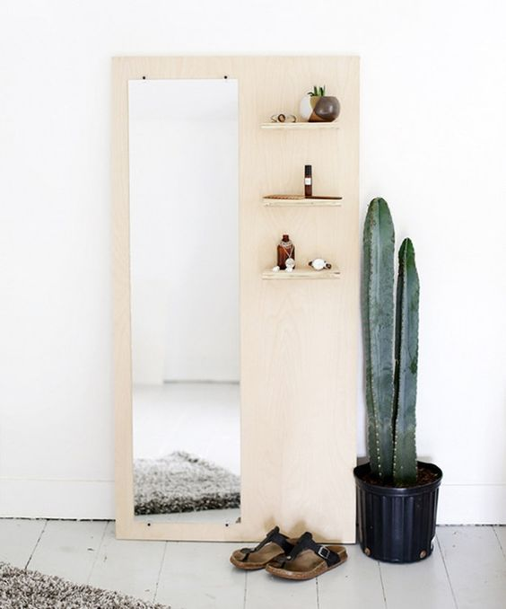 plywood with mirror and some little shelves