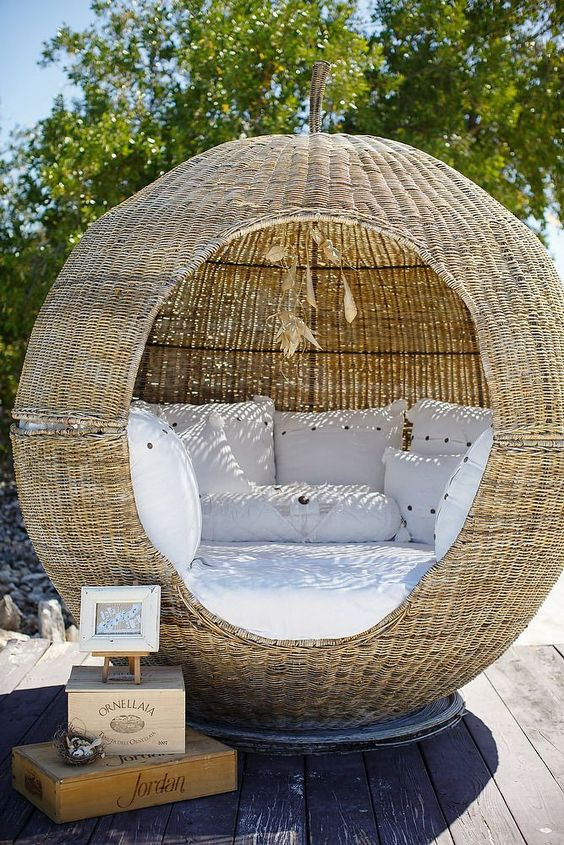 rattan ball bench with white cushioin and pillows inside