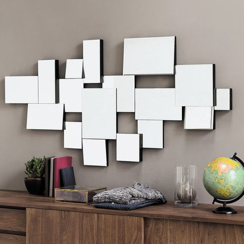 rectangle mirrors with different sizes and arrangements spread on the wall