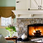 Shiplap Over Fireplace Stone Fireplace Green Wall Brown Valance White Window Tray Wooden Side Table Black Tufted Ottoman Blue Armchair Pillow