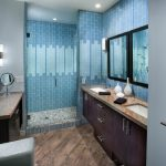 Shower Pan Tiles Blue Wall Tiles Mosaic Floor Tile Wooden Vanity Double Sink Wall Mirrors Wall Sconces Granite Top Towel Holder Glass Shower Door
