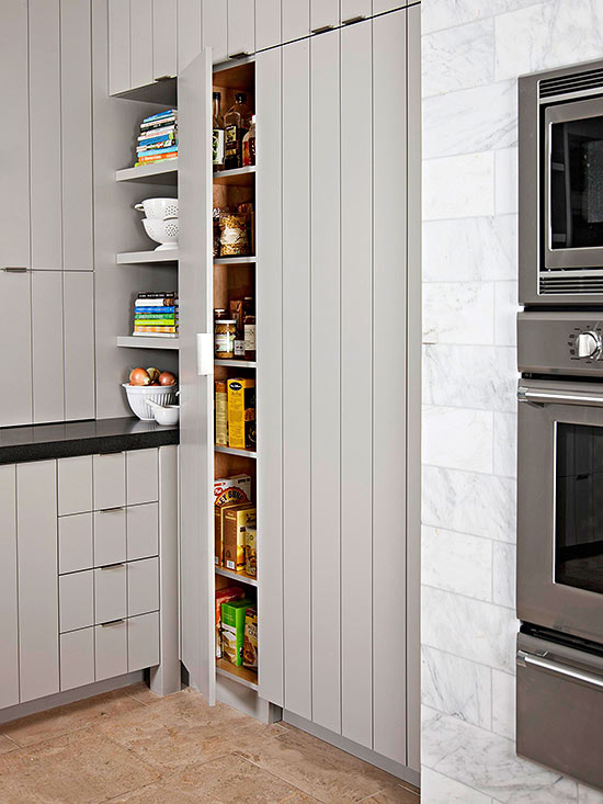 simple built in pantries on shelves closed by wooden door