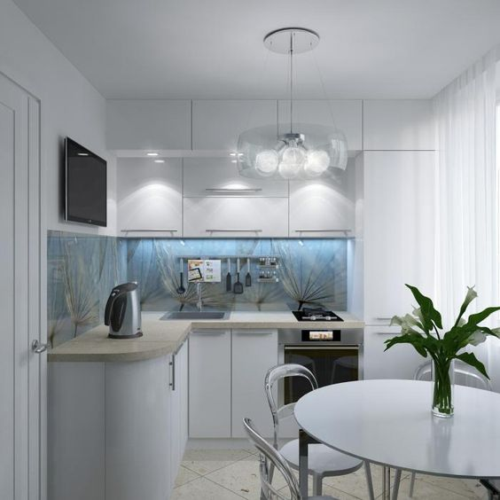 small corner kitchen, white floor tiles, white curvy bottom cabinet, white upper cabinet, white glass pendant, white round table, white chair
