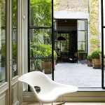 Small Garden, Grey Brick Floor, Plants, Glass Door, Plants With Wooden Pots