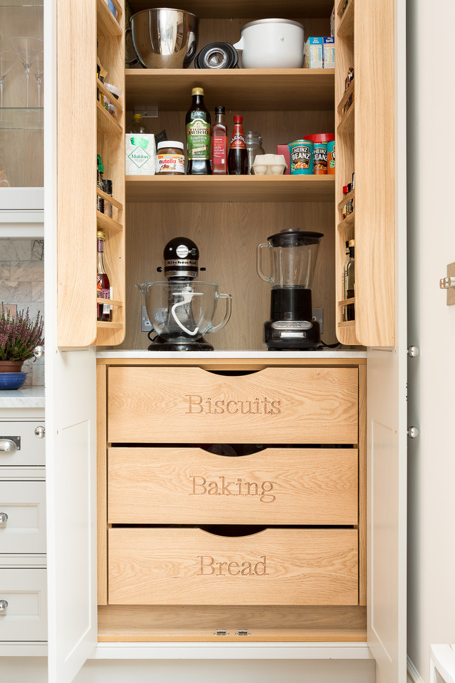 small kitchen appliance storage small pantry wooden drawers wooden shelves doorshelves white drawers backsplash