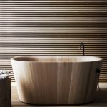 Smooth Wooden Bath Tub With Sleek Lines, Wooden Slabs Floor And Wall