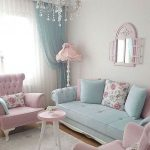 Soft Blue Sofa With Tudted Seating, Tufted Arm Rest, Pink Chairs With Tufted Back, Pink Roudn Side Table, Chandelier, Pink Lamp Floor, Mirror