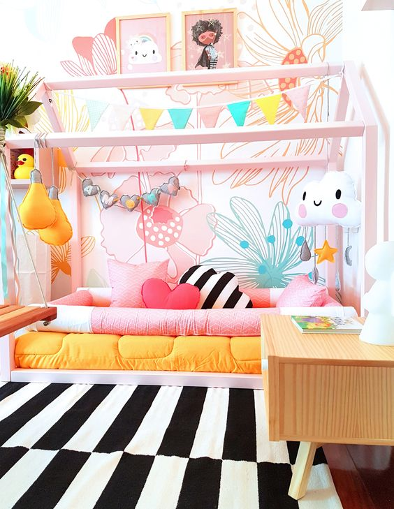 soft colored big flowers wallpaper, pink wooden bed platform, black white stripe rug, low wooden bedside table