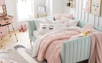 square blue velvet daybed, white seating, pillows, pink blanket