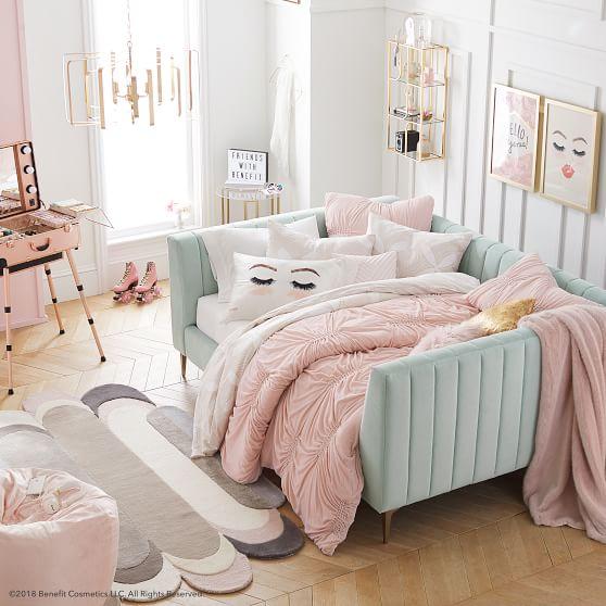 square blue velvet daybed, white seating, pillows, pink blanket