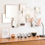 Square Mirrors Overlaping Without Pattern On The Wall Above Wooden Cabinet