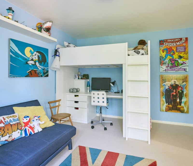 superhero room superhera wall art white wall mounted shelf white bunk bed white built in desk white chair colorful rug blue couch wooden chair pillows