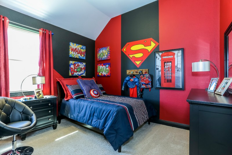 superhero room superman themed bedroom black and red wall blue bedding table lamp dresser red curtain window chair wall mirror