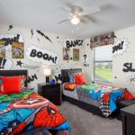 Superhero Room Wallpaper Black Bed Headboard Black Nightstand Table Lamp Colorful Superhero Bedding Wall Decoration Dresser Ceiling Fan With Lighting Stools