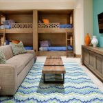 Taupe Sofa Colorful Rug Wooden Bunk Bed Blue Bedding Wooden Coffee Table Basket Colorful Pillows Tosca Accent Wall Window