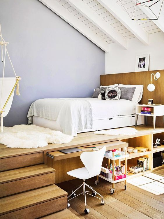 teen bedroom, brown natural wooden platform, sliding table under the platform, shelves under the platform, hammock, white bed platform bed on top
