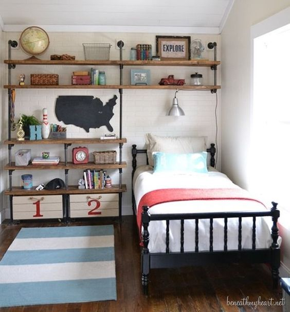teen room, wooden floor, white wooden plank wall, shelves on one side of the wall with boxes at the bottom