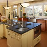 The Sink Stovetop Yellow Island Wooden Cabinet White Framed Glass Windows Oven Pendant Lamps Black Countertops Shelves Black Barstools