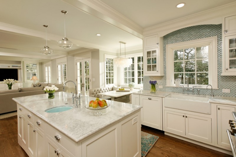 the sink white cabinet white island glass pendant lamps glass window french doors white countertop kitchen rug stovetop dining table chandelier