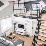 Two Levels House, Wooden Floor, Wooden Stairs With Black Rail, Grey Sofa, Living Room On Ground, Glass Partition With Black Metal Frame, Bedroom On The Upper Level, Pastel Wall