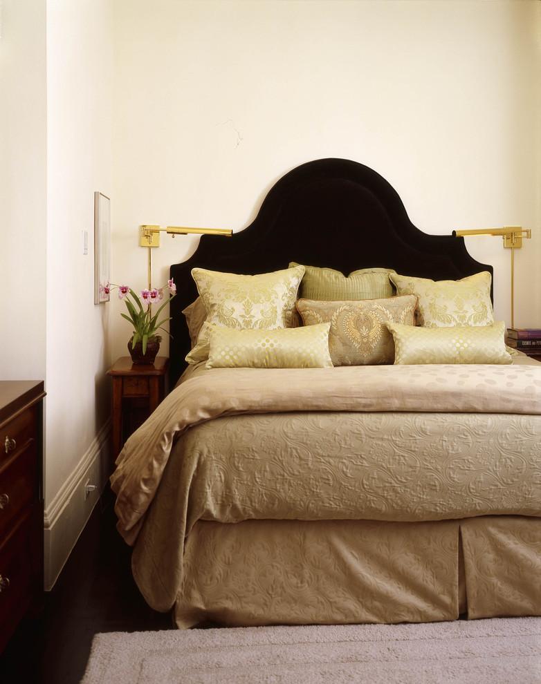 very narrow bedside table black headboard wooden dresser gold wall sconces silk pillows beige beding grey rug white walls drawer