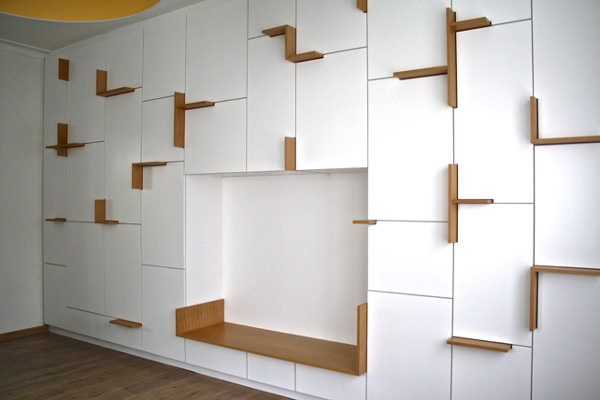 white cupboard with nook, wooden seating, white side, wooden lines between the door