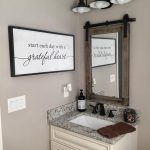 White Wooden Cabinet With Grey Marble Top, Wood Frmed Mirror, Sconces