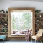 Window Seat, Thick Wooden Framed, Pink Cushions And Pillows, Wooden Shelves, Plants, Chairs, Blue Rug