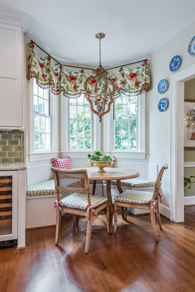 window swag valances colorful swag white windows wooden floor built in bench round wooden table green backsplash chandelier wooden chair wine cellar
