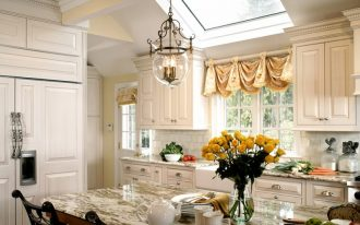 window swag valances glass pendant lamp white cabinet marble countertopp sink white backsplash whte glass window black barstool skylight glass doors roman shade