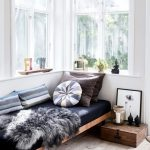Wooden Bed Platform, Black Cushion, Pillows, Near The Window