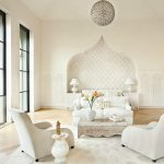 Moroccan Arch Wall In The Living Room With Square Textured Inside Wall, White Wall, Arh Wainscoting, Wooden Floor, White Sofa, White Chairs, White Rug, Moroccan Styled Globe Pendant