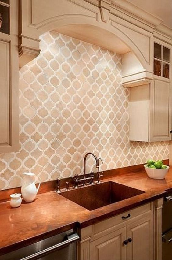 arabesque backsplash tile, arch ceiling, white upper cabnet, brown marble kitchen top, silver cabinet