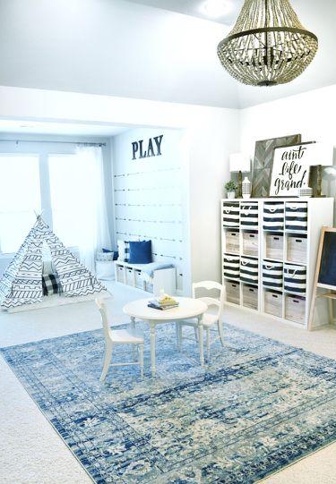 basement, white rug, blue rug, white wall, chandelier, white shelves, white tent, white bench