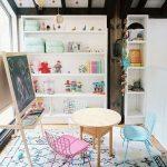 Basement, Wooden Floor, White Rug, White Wall, White Wooden Shelves, Low Study Set, Blackboard, Windows