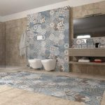 Bathroom, Brown Tiles, Patterned Blue Hexagonal Tiles On The Wall And Floor, White Floating Toilet, Wooden Floating Vanity With Shelves