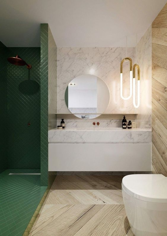 bathroom, green tiny square wall tiles, white marble wall backsplash, wooden floor and wall tiles, white floating toilet, round mirror