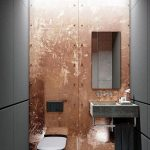 Bathroom, Grey Floor Tiles, Grey Wall, Golden Copper Statement Wall, Grey Floating Sink, Mirror, Black Toilet