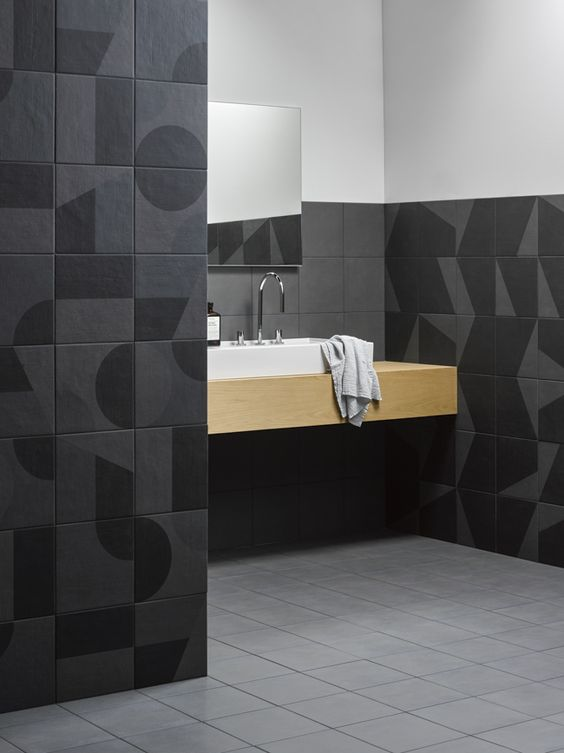 bathroom, light grey floor tiles, black abstract wall tiles, wooden floating venity with white sink