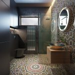 Bathroom, Mosaic Tiles On The Floor And Walls, Black Tiles On Wall, Black Toilet, Middle Dented Shelves, Round Mirror, Wooden Floating Vanity With Sink