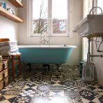 Bathroom, Patterned Tiles, White Wall, Green Tub, Floating Sink, Wooden Floating Shelves, Glass Windows