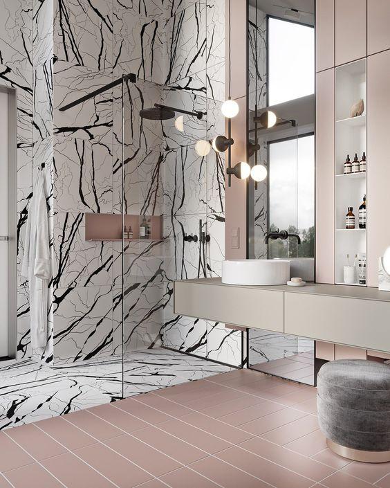 bathroom, pink abthroom floor tiles, patterned marble wall, pink backsplash, grey floating vanity, white sink, sconce,  glass partition